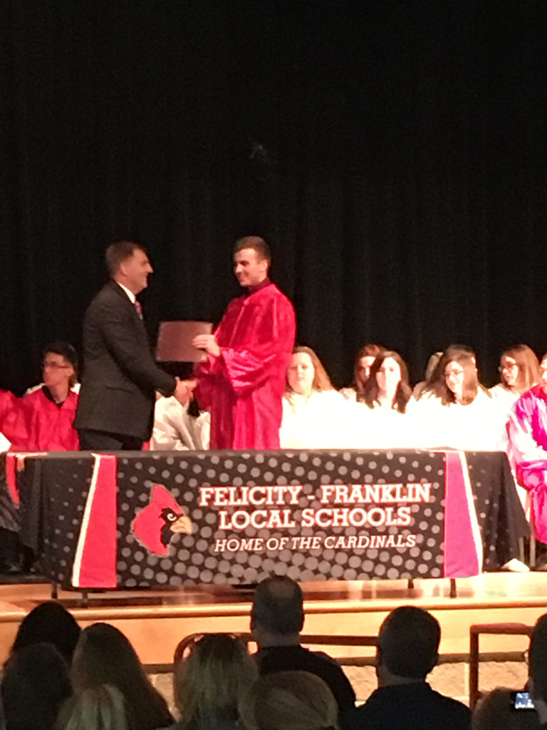 Austin Perry accepting an Award from Mr. Walker during tonight's Senior Award Ceremony