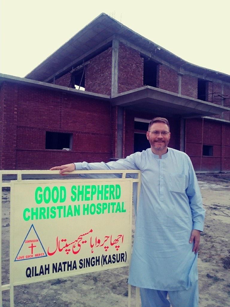 Mr. Van Huss in a cultural Pakistani suit at a hospital being built.