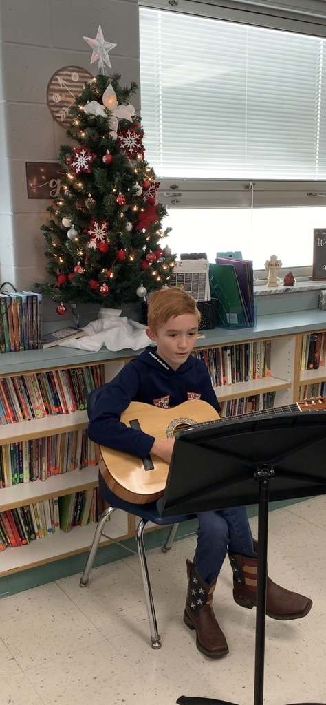 "6th grader, Clayton Myers, shares his musical talent with the Christmas song, ""Oh Christmas Tree""."