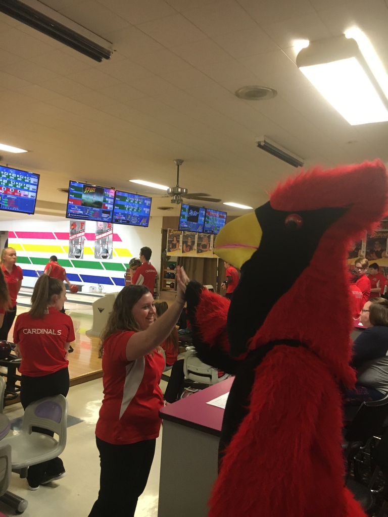 Mallory Taulbee gets a high five from the Cardinal after picking up a tough spare!